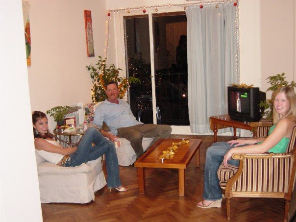My dad, best friend, and I in my sister's apartment in Argentina, circa December 2005.